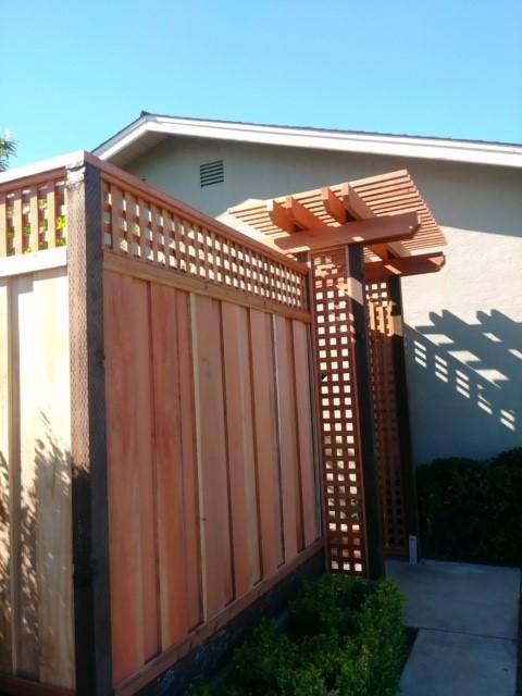 redwood good neighbor fence with lattice and pergola above gate 94513