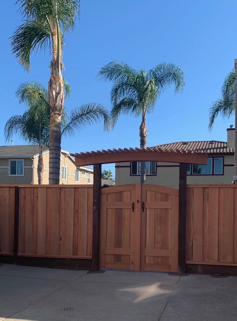 arched redwood gate with pergola on top Tracey, CA