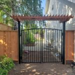 arched metal gate redwood pergola San Jose, CA