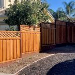 multi-tiered good neighbor redwood fence with lattice Discovery Bay, CA