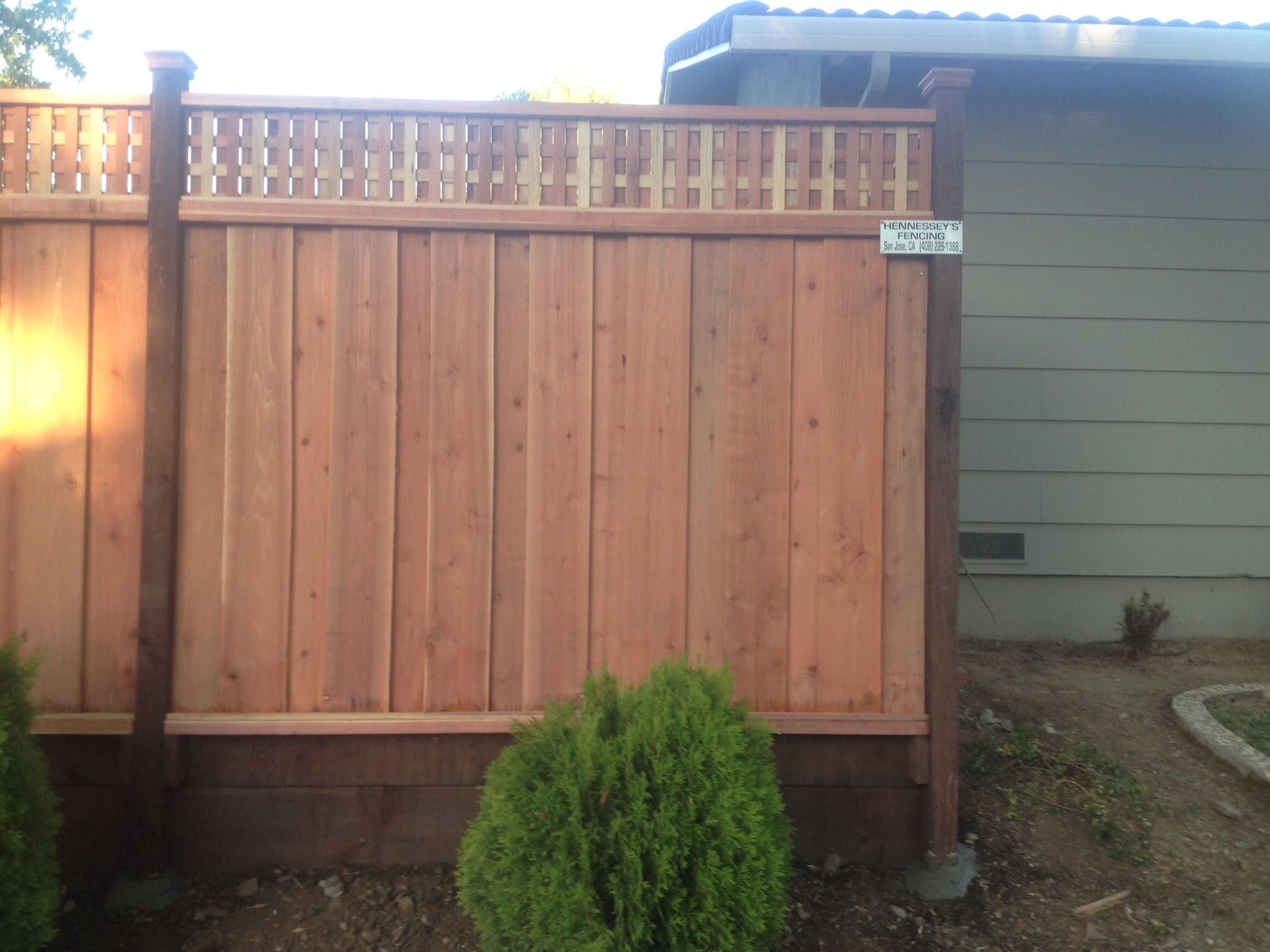 redwood fence with unique lattice hennessey's fencing 94513