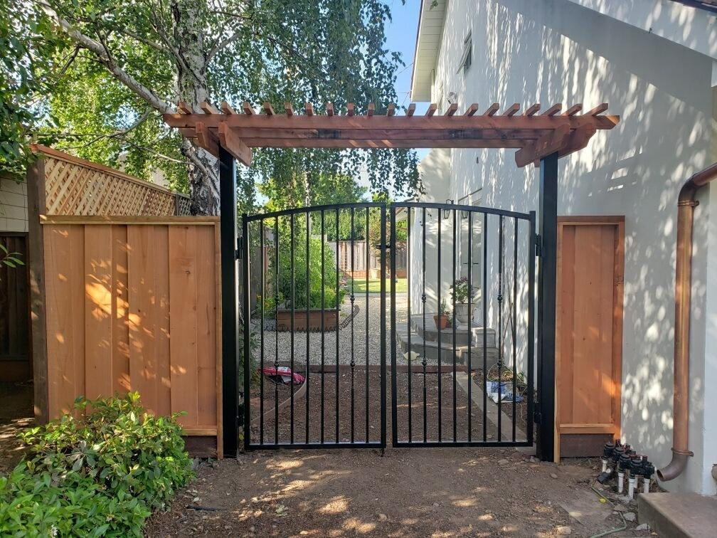 iron gate redwood fence pergola residential Brentwood, CA