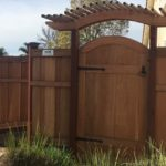 arched wood gate with arched pergola Moraga, CA
