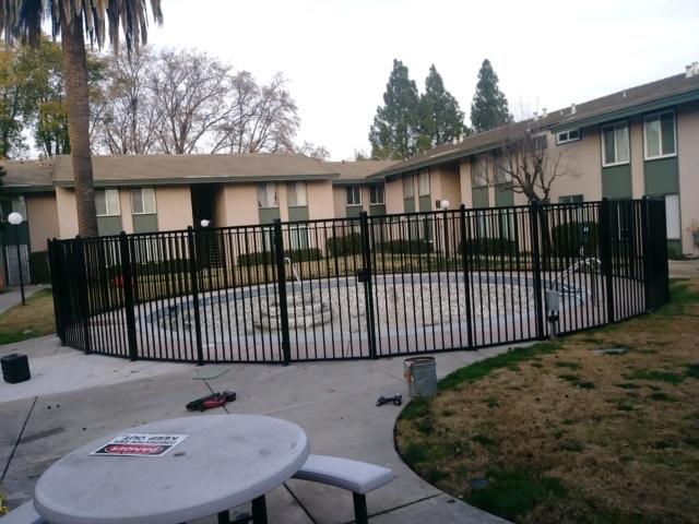 iron gate around swimming pool 94513