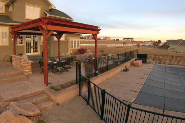 backyard redwood pergola and iron pool fence 94513