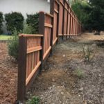 tiered redwood fence with lattice Brentwood, CA