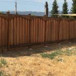backyard redwood privacy fence with caps and arch Discovery Bay, CA