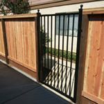 metal gate with wood fencing Oakley, CA
