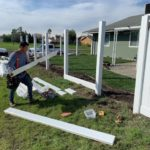 white vinyl fence under construction Antioch, CA