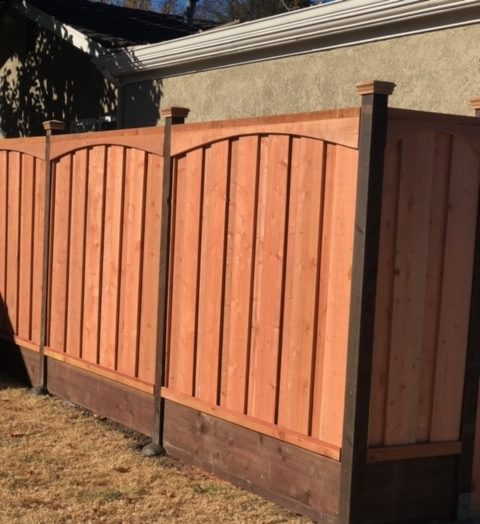 picture frame board on board fence with caps and top arch design Brentwood, CA