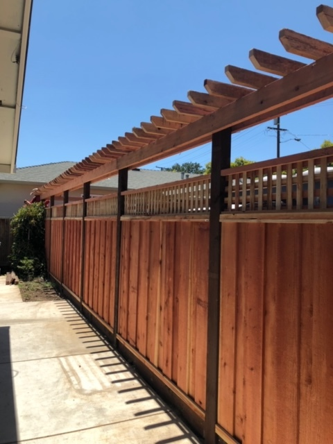 redwood fence with pergola top
