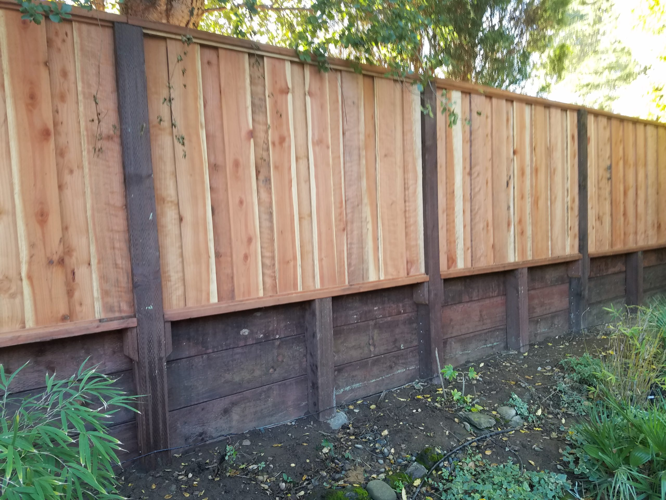 redwood fence above retaining wall Oakley, CA