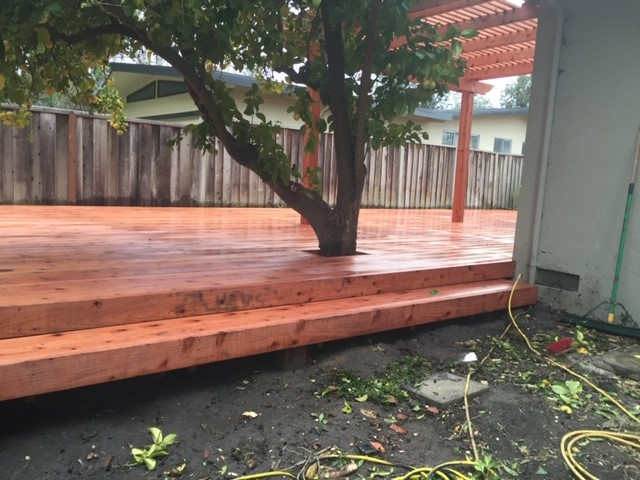 backyard deck with hole for tree Brentwood, CA