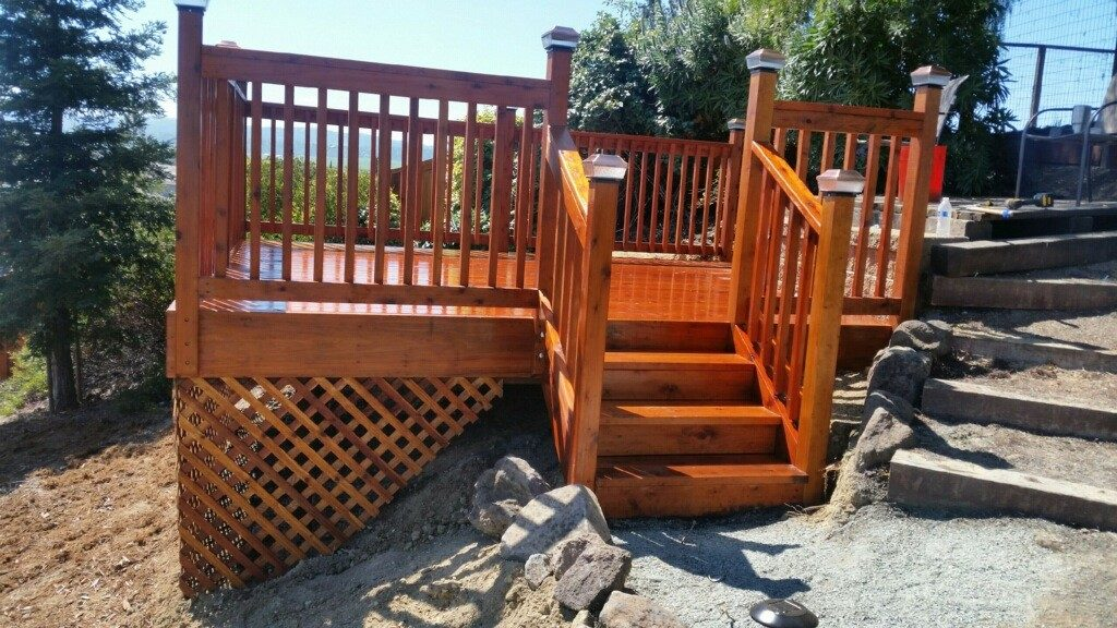 redwood deck with railing on sloped property Oakley, CA